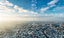 Paris Skyline In Winter With View Of Eiffel Tower At Sunset