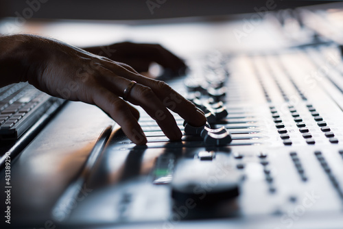 Making mix-down of song on mixing console in recording studio