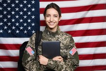Female Cadet With Backpack And Tablet Against American Flag. Military Education