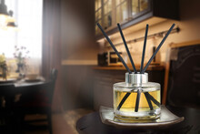 Luxury Aroma Reed Diffuser Crystal Glass Bottle Is On The Black Marble Table To Creat Romance And Relax Ambient In Dinning Room During Dinner On Valentine Day Of A Couple Lovers