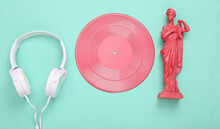 Creative Music Layout. Pink Antique Greek Muse Statue With Vinyl Record And Headphones On Mint Blue Background. Inspiration. Minimalism. Flat Lay. Top View.