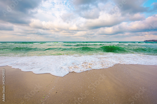 Fototapeta evening landscape at the sea. beautiful nature scenery. summer vacation concept. dramatic sky above the horizon. waves run on sandy beach obraz