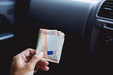 A Male Businessman Pays Taxi Fare In Euros With A Tip For Excellent Service. Business Concept.
