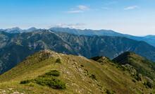 Retezat Mountai Range From Coada Oslei Hill Summit In Valcan Mountains In Romania