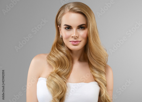 Beautiful woman with long blonde hairstyle healthy beauty skin natural make up