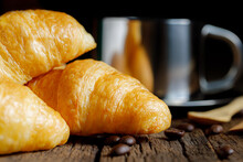 Close Up Of Pile Of Delicious Croissants On A Dark Background.