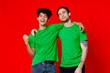 Leinwandbild Motiv funny friends green t-shirts hugs emotions joy red background