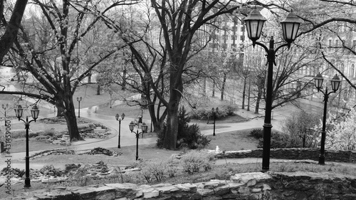 Fotografiet Black and white photo from the bastion hill in Riga in the morning in the rain