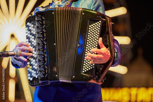 Fotografia, Obraz A musician performing on an accordeon, close-up, Sheikh Zayed Festival