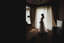 Morning Of The Bride. The Bride Is Waiting For The Groom. Exciting Happy Wedding Morning. Full-length Photo. Backlight.