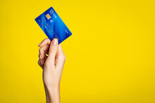 Female Hand Holding Bank Credit Card