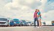 Leinwandbild Motiv Woman and man choosing camper van to rent or buy