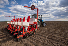 Agriculture Farm Tractor Farmer Seeding Machine Field Seeder Village Planter Rural Working Combine Tillage Plowing Agricultural Equipment Season Sowing Grain Spring Time Process Planting Seeds Ground
