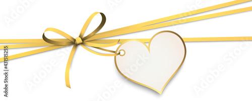 Obraz na plátně gold ribbon bow with heart hang tag
