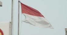 Handheld Shot Of Indonesian Flag Fluttering