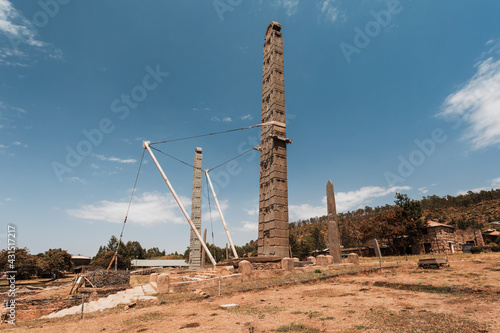 Fotografie, Obraz Aksumite civilization ruins, Ancient monolith stone obelisks behind Church of Our Lady of Zion, symbol of the Aksum, Ethiopia