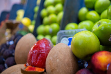 Colorful Fruit Stand With Mamey, Green Apples, And More