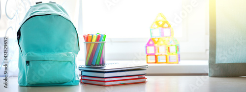 Obraz Banner. Concept back to school. Full turquoise School Backpack with stationery on table. - fototapety do salonu