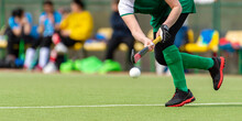 Hockey Player Woman With Ball In Attack Playing Field Hockey Game