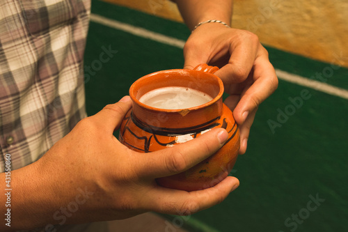 Obraz na plátně Indigenous man drinking Pulque, a traditional Mexican drink made from mead that is extracted from the maguey