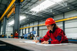 canvas print picture Engineer working on project at heavy industry factory.