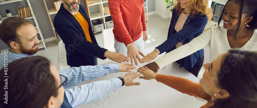 Fotografie, Obraz Banner with group of positive multiracial teammates, business partners, or friends joining hands