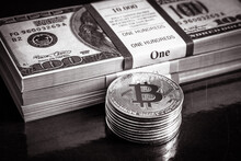 Bitcoin And Dollar Cash Stacks, Crypto Currency Bit Coins In Black And White