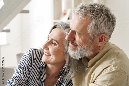 Canvastavla Happy older mature classy couple hugging, bonding, thinking of good future