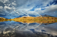 Rainbow In Patagonia, Reflection In A Lake