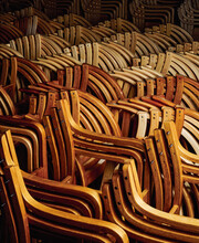 Wooden Chair Frames Stacked Together