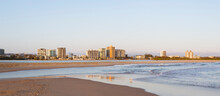 Looking Across Beach At Low Tide And Early Morning To Maroochydore Township And High Rise Buildings