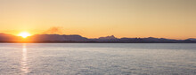 Panorama Looking Across Water At Sun Setting Towards Tweed Hills From Byron Bay - Australia