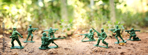 group of toy soldiers outdoors - fototapety na wymiar