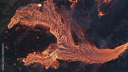 Canvas-taulu lava eruption volcano with snowy mountains, Aerial view Hot lava and magma comin
