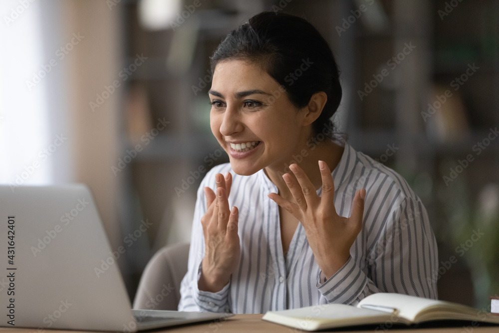 Leinwandbild Motiv - fizkes : Close up overjoyed Indian woman looking at laptop screen, reading good news in email message, received money refund, job promotion or great exam results, excited businesswoman making video call