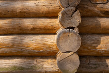 Corner Of Wall Of Ancient Wooden Log House. Historical Rural Background.