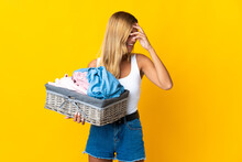 Young Blonde Uruguayan Woman Holding A Clothes Basket Isolated On Yellow Background Laughing