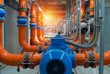 Pipes And Valves.Industrial Water Condenser Pump And  HVAC  Air Conditioning System And Pipping Line Of Industrial Construction At Chiller Plant  Room System In The Factory.