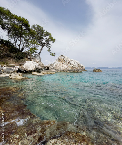 Picturesque Mediterranean wild beach harbor on the Turkish sea rocky coast near from Antalya