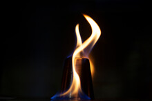 Burning Alcohol. Dark Background With Tongues Of Flame. Alcohol Inflammation. Fire On Metal. Two Tongues Of Flame. Preparation For Drinking A Strong Alcoholic Drink. Fire Blue And Orange.