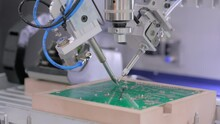 Process Of Selective Soldering Components To Printed Circuit Board At Factory, Exhibition - Close Up View. Automated Technology, Industrial, Robotic, Electronic, Production, Manufacturing Concept