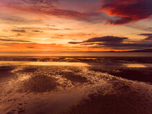 Beautiful Sunset Colors Over The Coastline Of Allerdale District In Cumbria, UK. Sun Setting Over The Shore Of Allonby Bay On Autumn.