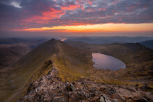 Breathtaking Sunrise At The Summit Of Helvellyn; One Of The Lake Districts Most Popular Mountain Hikes. Swirral Edge, Red Tarn And Ullswater Can Be Seen In The Background.