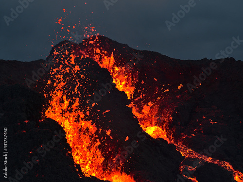 Obraz na plátne Stunning closeup view of erupting volcano in Geldingadalir valley near Fagradalsfjall mountain, Grindavík, Reykjanes peninsula, southwest Iceland with ejection of hot, glowing lava in the dark