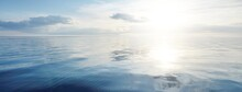Clear Blue Sky With Cirrus And Cumulus Clouds Above The Baltic Sea At Sunset. Idyllic Seascape. Travel, Sailing, Cruise, Recreation, Vacations. Symmetry Reflections In The Water, Natural Mirror