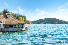 The Lakefront Downtown, Marina, Beach And Tubbs Hill Are Viewed From A Floating Restaurant On The Lake In Coeur D'Alene, Idaho, USA
