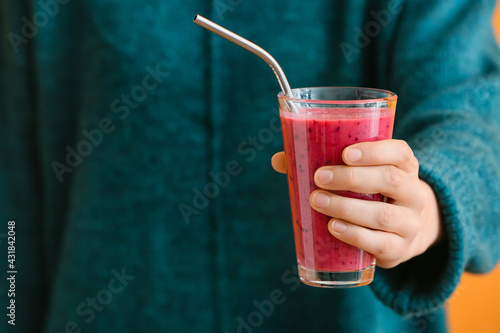Obraz Woman with glass of fruit smoothie on color background - fototapety do salonu