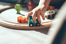 Close Up Photo Of A Baby On The Floor Playing With Train Toys Simulating Driving