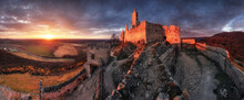 Ruin Of Castle Plavecky In Slovakia - Panorama Of Dramatic Sunset