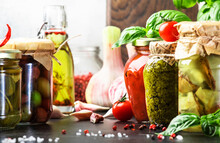 Fermented, Pickled, Marinated Preserved Vegetarian Italian Vegetables And Sauces. Organic Sun-dried Tomatoes, Artichokes, Capers, Olives, Marinara Sauces, Pesto In Jars With Spice And Herbs